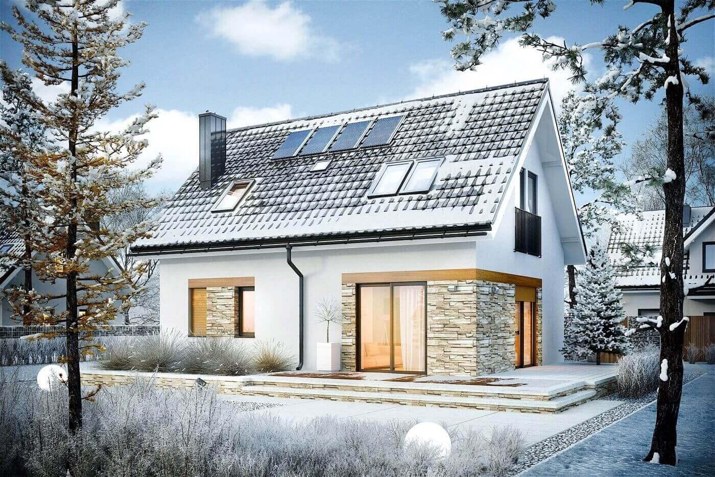 Ośnieżony dom z zamarzniętymi roletami zewnętrznymi